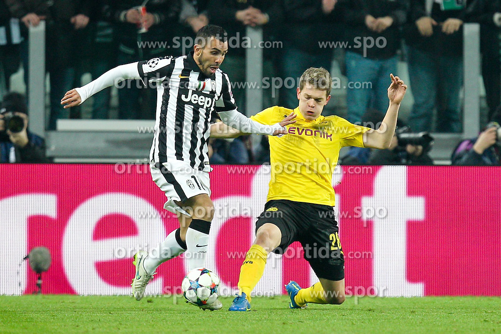 24.02.2015, Veltins Arena, Turin, ITA, UEFA CL, Juventus Turin vs Borussia Dortmund, Achtelfinale, Hinspiel, im Bild l-r: im Zweikampf, Aktion, mit Carlos Tevez #10 (Juventus Turin) und Matthias Ginter #28 (Borussia Dortmund) // during the UEFA Champions League Round of 16, 1st Leg match between between Juventus Turin and Borussia Dortmund at the Veltins Arena in Turin, Italy on 2015/02/24. EXPA Pictures &copy; 2015, PhotoCredit: EXPA/ Eibner-Pressefoto/ Kolbert<br /> <br /> *****ATTENTION - OUT of GER*****
