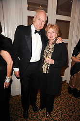 PETER SNOW and his wife ANN MacMILLAN at a gala dinner in celebration of 80 years since the first Foyles Literary Luncheon, held in The Ball Room, Grosvenor House Hotel, Park Lane, London on 21st October 2010.