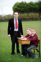 Principal of the national school in Kilimor, Co. Galway, Gerard Murray  with Pupils Ailbhe Hardiman and Jack O Meara in the place where their school should be.   .  Photo:Andrew Downes