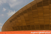 Exterior of the £105m Siberian Pine Velodrome curved roof during the London 2012 Olympics. The London Velopark is a cycling centre in Leyton in east London. It is one of the permanent Olympic and Paralympic venues for the 2012 Games. The Velopark is at the northern end of Olympic Park. It has a velodrome and BMX racing track, which will be used for the Games, as well as a one-mile (1.6 km) road course and a mountain bike track.[2] The park replaces the Eastway Cycle Circuit demolished to make way for it. This land was transformed to become a 2.5 Sq Km sporting complex, once industrial businesses and now the venue of eight venues including the main arena, Aquatics Centre and Velodrome plus the athletes' Olympic Village.