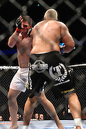 "LONDON, ENGLAND, JUNE 7, 2008: Antoni Hardonk (facing) is stunned by a left jab from Eddie Sanchez during ""UFC 85: Bedlam"" inside the O2 Arena in Greenwich, London on June 7, 2008."