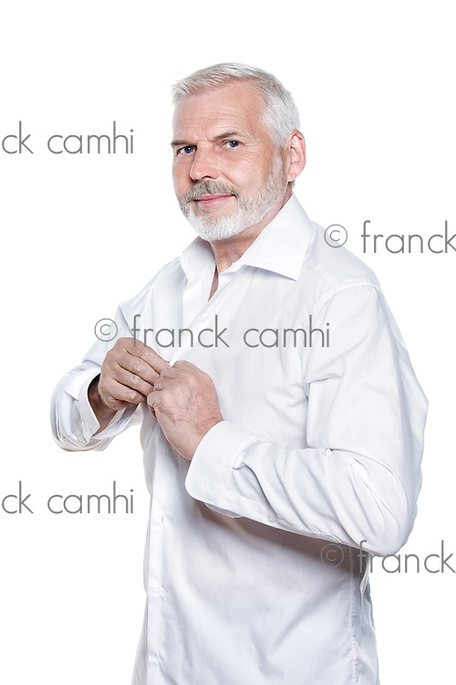 caucasian senior man fasten shirt portrait isolated studio on white background