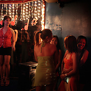 Girls frequenting a karaoke bar on October 10, 2008 in Adriatico Street, Malate, Manila, the Philippines. Karaoke is extremely popular in the Philippines. Photo Tim Clayton