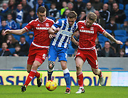 Brighton striker James Wilson is sandwiched by Middlesbrough FC defender Ben Gibson & Middlesbrough FC midfielder Adam Clayton during the Sky Bet Championship match between Brighton and Hove Albion and Middlesbrough at the American Express Community Stadium, Brighton and Hove, England on 19 December 2015. Photo by Bennett Dean.