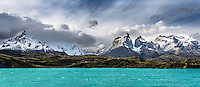 A panorama of the Cerro Paine Grande and the Cuernos del Paine from Lago Pehoé in Torres del Paine National Park, Chile.