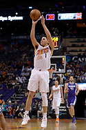 Mar 15, 2017; Phoenix, AZ, USA; Phoenix Suns guard Devin Booker (1) shoots the ball against the Sacramento Kings in the first half at Talking Stick Resort Arena. Mandatory Credit: Jennifer Stewart-USA TODAY Sports