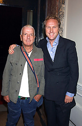Left to right, NICKY HASLAM and SIMON MILLS at a party hosted by Dom Perignon and Vanity Fair magazine to celebrate the launch of a unique collection of essays based on the theme of seduction to raise money for the charity English Pen. The paty was held at the Dom Perignon Mallroom,  13 Grosvenor Crescent, London W1 on 8th September 2004.