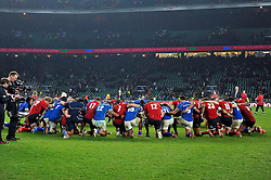 The England and Samoa teams huddle together after the match - Photo mandatory by-line: Patrick Khachfe/JMP - Mobile: 07966 386802 22/11/2014 - SPORT - RUGBY UNION - London - Twickenham Stadium - England v Samoa - QBE Internationals