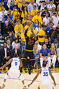 Cleveland Cavaliers forward LeBron James (23) shoots a jumper over Golden State Warriors forward Andre Iguodala (9) during Game 2 of the NBA Finals at Oracle Arena in Oakland, Calif., on June 4, 2017. (Stan Olszewski/Special to S.F. Examiner)