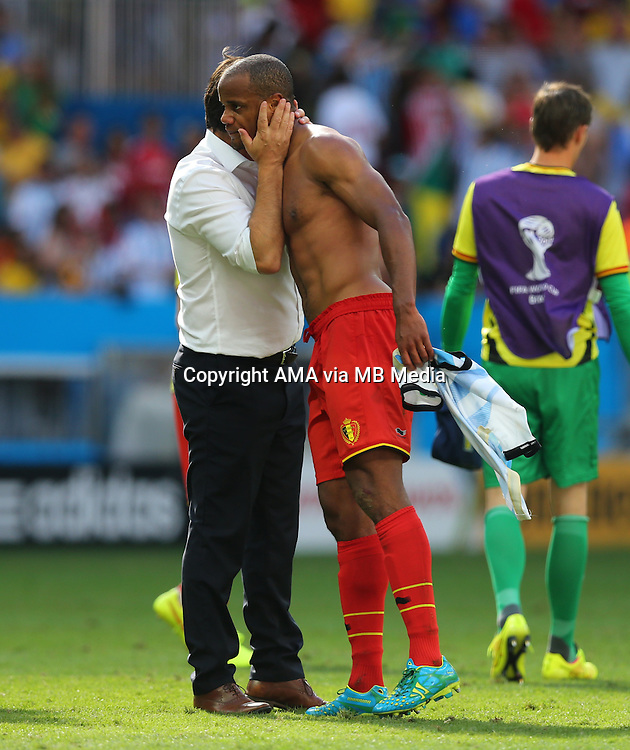 A dejected Captain Vincent Kompany of Belgium gets a hug from Marc Wilmots manager / head coach of Belgium at the end of the match in which Belgium were knocked out  of the FIFA World Cup
