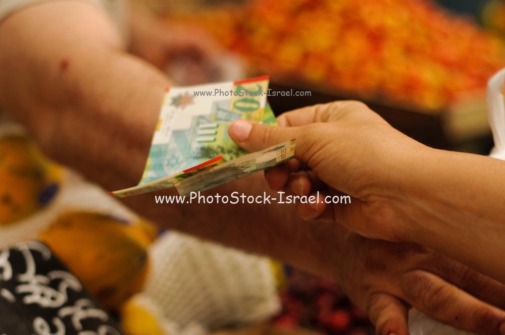 Israel, Jerusalem, Machane Yehuda market, Money changing hands, buyer paying for goods