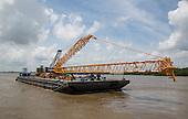 Sarens - barge docks to unload crane