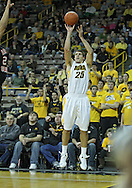 December 04 2010: Iowa Hawkeyes guard Eric May (25) puts up a three point shot during the first half of their NCAA basketball game at Carver-Hawkeye Arena in Iowa City, Iowa on December 4, 2010. Iowa won 70-53.