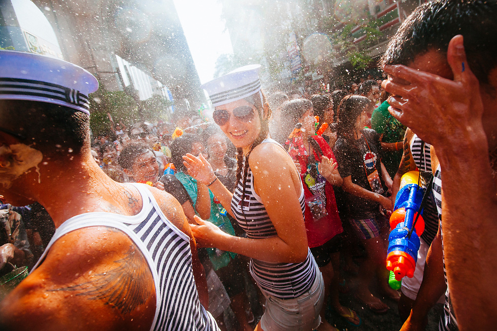 A parade moves through the Patpong district of Bangkok during the annual Songkran festival, celebrating the Thai New Year. Once a means of observing tradition by washing away the past year, Songkran is now essentially a nationwide water fight.