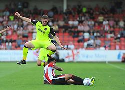 Jordan Cranston of Cheltenham Town tackles Pierce Sweeney of Exeter City-Mandatory by-line: Nizaam Jones/JMP - 26/08/2017 - FOOTBALL - LCI Rail Stadium - Cheltenham, England - Cheltenham Town v Exeter City - Sky Bet League Two