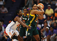 Sep 17, 2011; Phoenix, AZ, USA; Seattle Storm forward Le'coe Willingham (34) is guarded by the Phoenix Mercury forward Nakia Sanford (43) during the first half at the US Airways Center.  The Mercury defeated the Storm 92 - 83. Mandatory Credit: Jennifer Stewart-US PRESSWIRE