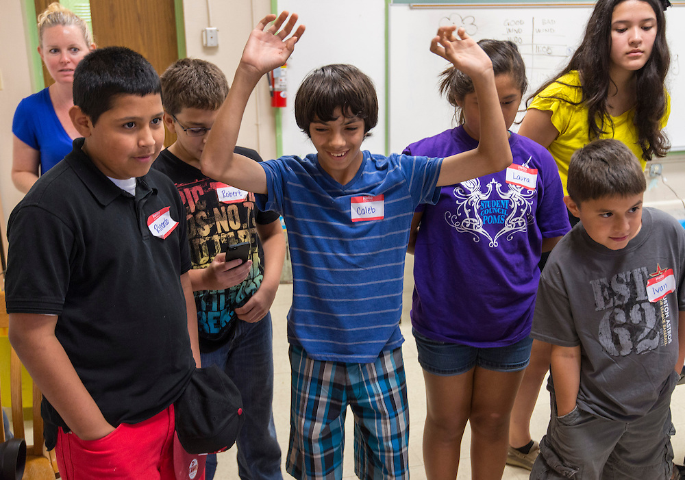 Students react to their successful experiment during the Greater Heights Science Extravaganza at Helms Elementary School, July 27, 2013.