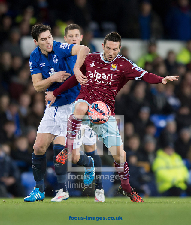 Morgan Amalfitano of West Ham United (right) is pressed by Gareth Barry of Everton during the FA Cup match at Goodison Park, Liverpool<br /> Picture by Russell Hart/Focus Images Ltd 07791 688 420<br /> 06/01/2015