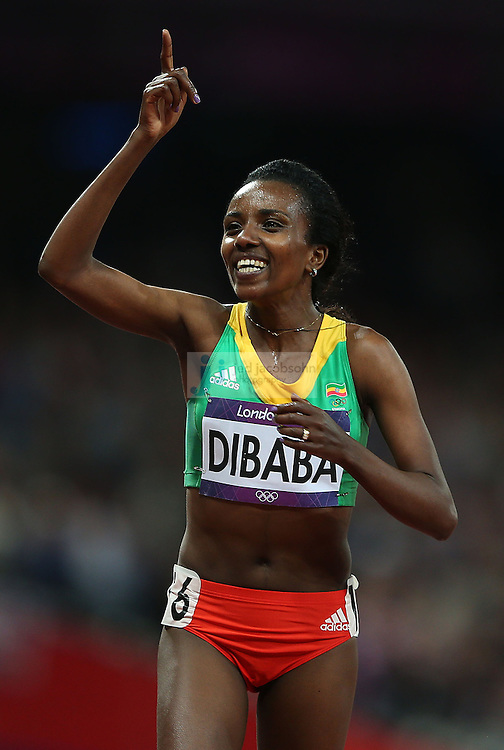 Tirunesh Dibaba of Ethiopia celebrates after winning the women's 10000m final during track and field at the Olympic Stadium during day 6 of the London Olympic Games in London, England, United Kingdom on August 3, 2012..(Jed Jacobsohn/for The New York Times)..
