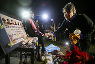 A supporter offers flowers to a memorial statue honoring 'Comfort Women' at Glendale Peace Monument during a candlelight vigil in remembrance and support of 'Comfort Women', Japanese military sexual slavery victims during World War II, on January 5, 2016, in Glendale, California. AFP PHOTO / Ringo Chiu