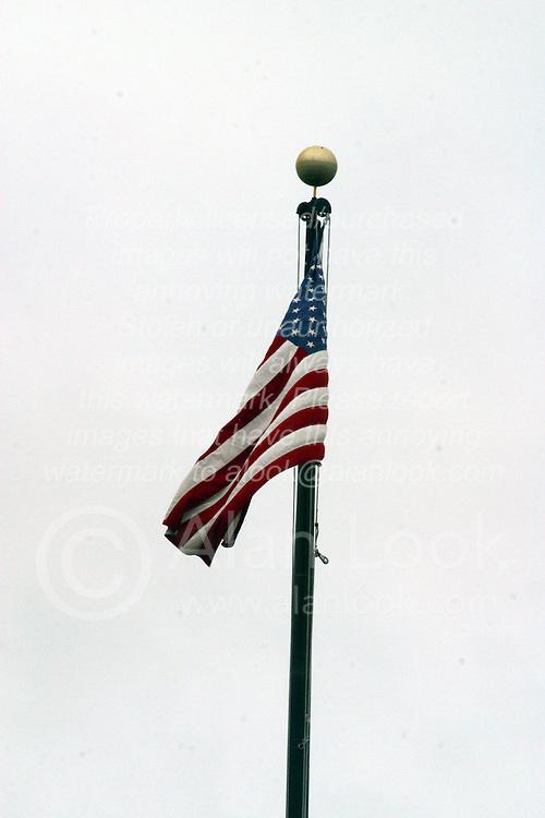 10 June 2006  American Flag flying against grey cloud background