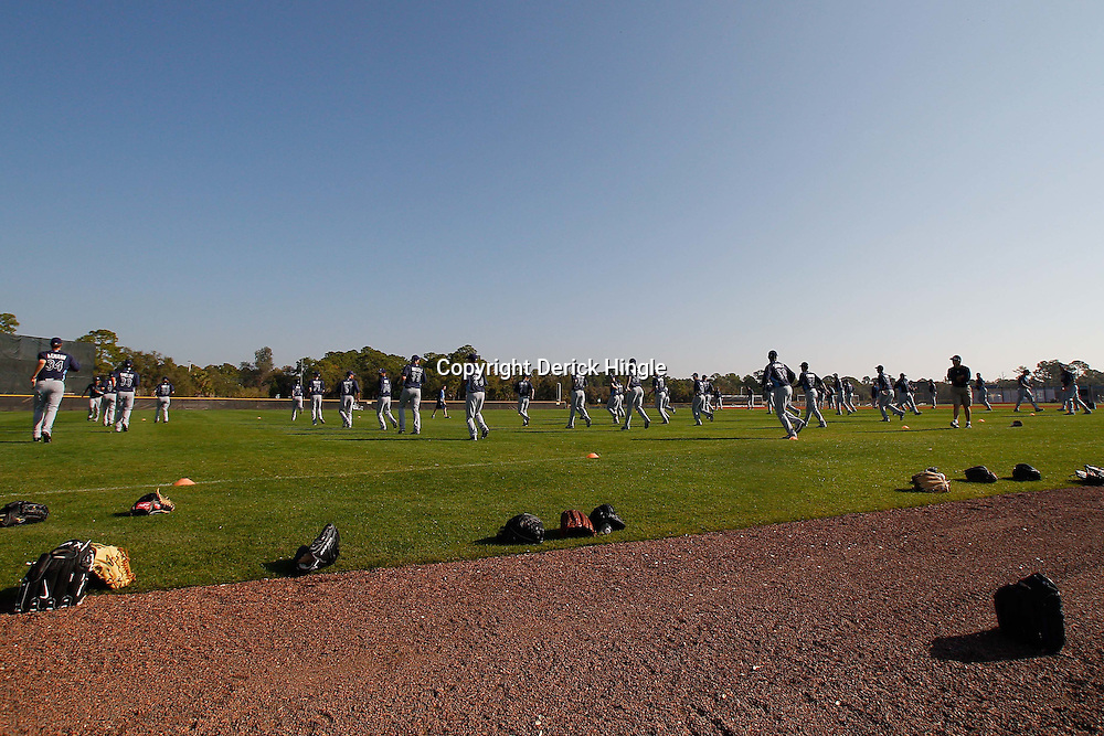 February 20, 2011; Port Charlotte, FL, USA; Tampa Bay Rays pitchers stretch on the field before the start of a spring training practice at Charlotte Sports Park.  Mandatory Credit: Derick E. Hingle