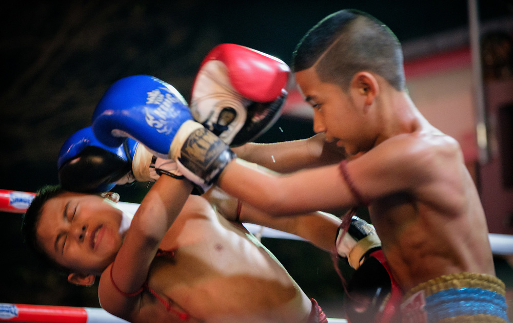 Young Muay Thai fighters compete at a festival in Nakhon Nayok Thailand.