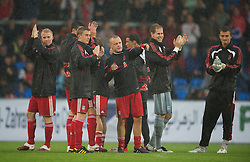 ALTACH, AUSTRIA - Saturday, July 17, 2010: Liverpool's Jay Spearing and Stephen Darby applaud the fans after their first preseason match of the 2010/2011 season, against Al-Hilal Al Saudi FC, had to be called off due to torrential rain and a waterlogged pitch at the Cashpoint Arena. (Pic by David Rawcliffe/Propaganda)