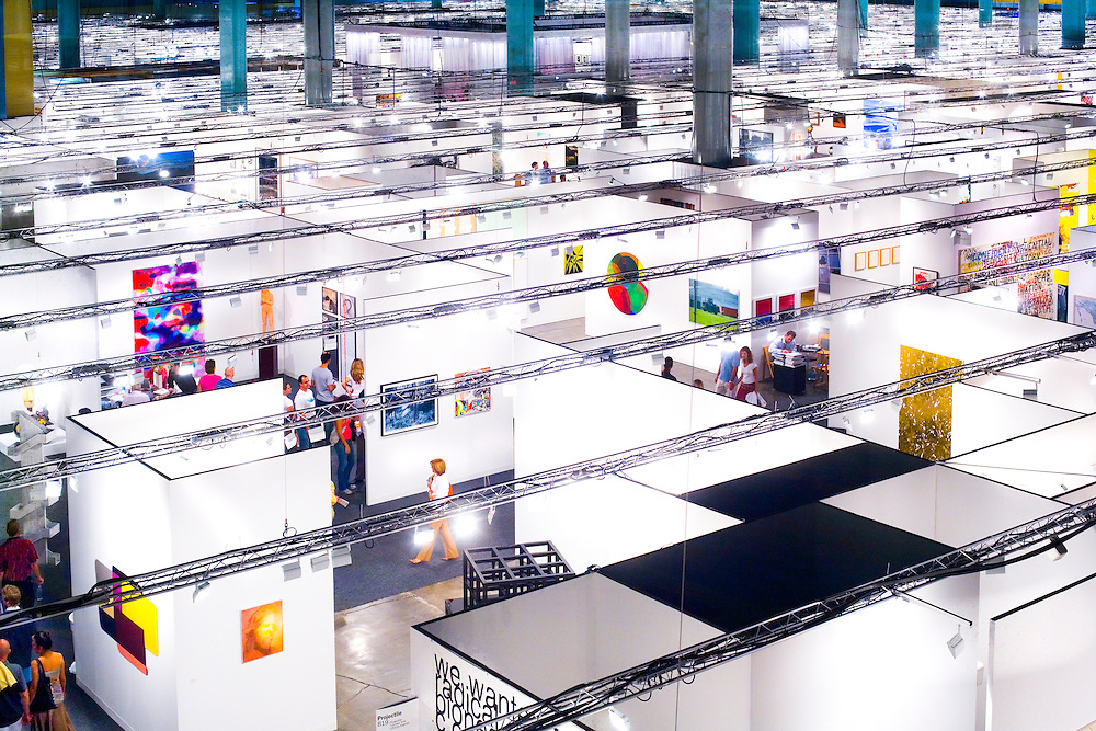 Aerial view of people browsing the gigantic Art Basel Miami Beach 2005 art fair in the Miami Beach Convention Center