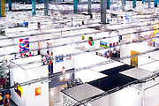 Aerial view of people browsing the enormous Art Basel Miami Beach art fair