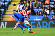 Stoke City defender Erik Pieters (3) fouls Leicester City midfielder Riyad Mahrez (26) during the Premier League match between Leicester City and Stoke City at the King Power Stadium, Leicester, England on 1 April 2017. Photo by Jon Hobley.