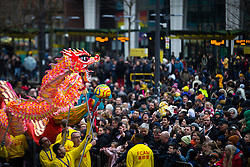 © Licensed to London News Pictures . 26/01/2020. Manchester, UK. A dragon dances in front of crowds in St Peter's Square . People celebrate Chinese New Year in Manchester with a display of oriental culture and a procession through the city centre . Photo credit: Joel Goodman/LNP