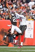 CLEVELAND, OH - NOVEMBER 2: Cornerback Joe Haden #23 of the Cleveland Browns blocks a pass intended for wide receiver Mike Evans #13 of the Tampa Bay Buccaneers during the first half at FirstEnergy Stadium on November 2, 2014 in Cleveland, Ohio. (Photo by Jason Miller/Getty Images)  *** Local Caption *** Joe Haden; Mike Evans