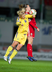 LLANELLI, WALES - Wednesday, April 9, 2014: Wales' Natasha Harding in action against Ukraine's Alla Lyshafay during the FIFA Women's World Cup Canada 2015 Qualifying Group 6 match at Parc-y-Scarlets. (Pic by David Rawcliffe/Propaganda)