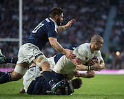 Twickenham, United Kingdom. Fullback, Mike BROWn is taken to ground during thr Six Nations International Rugby, Calcutta Cup Game, England vs Scotland, RFU Stadium, Twickenham, England, <br />