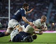 Twickenham, United Kingdom. Fullback, Mike BROWn is taken to ground during thr Six Nations International Rugby, Calcutta Cup Game, England vs Scotland, RFU Stadium, Twickenham, England, <br /> <br /> Saturday  11/03/2017<br /> <br /> [Mandatory Credit; Peter Spurrier/Intersport-images]