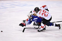 PYEONGCHANG, Feb. 22, 2018  Marie-Philip Poulin of Canada (R) vies for the puck with Gigi Marvin of the United States during women's ice hockey final between Canada and the United States at Gangneung Hockey Centre, in Gangneung, South Korea, Feb. 22, 2018. The United States beat Canada in shootout to win the women's ice hockey gold medal at the Winter Olympic Games here on Thursday. (Credit Image: © Ju Huanzong/Xinhua via ZUMA Wire)