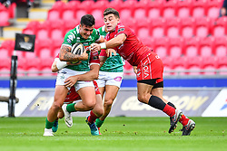 Marco Zanon of Benetton Treviso is tackled by Kieron Fonotia of Scarlets<br /> <br /> Photographer Craig Thomas/Replay Images<br /> <br /> Guinness PRO14 Round 3 - Scarlets v Benetton Treviso - Saturday 15th September 2018 - Parc Y Scarlets - Llanelli<br /> <br /> World Copyright © Replay Images . All rights reserved. info@replayimages.co.uk - http://replayimages.co.uk