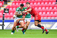 Marco Zanon of Benetton Treviso is tackled by Kieron Fonotia of Scarlets<br /> <br /> Photographer Craig Thomas/Replay Images<br /> <br /> Guinness PRO14 Round 3 - Scarlets v Benetton Treviso - Saturday 15th September 2018 - Parc Y Scarlets - Llanelli<br /> <br /> World Copyright &copy; Replay Images . All rights reserved. info@replayimages.co.uk - http://replayimages.co.uk