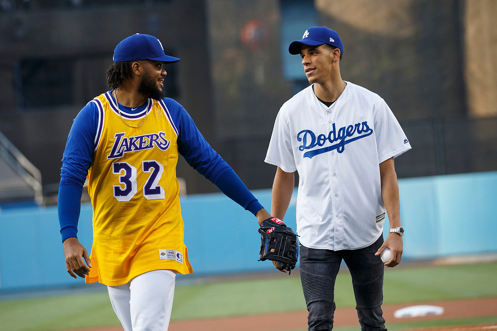 Dodgers pitcher Kenley Jansen, wearing a Lakers jersey, shares a moment with Lakers draft pick Lonzo Ball after he threw out the first pitch at Dodger Stadium on Friday, June 23, 2017 in El Segundo, California. The Lakers selected Lonzo Ball as the No. 2 overall NBA draft pick and is the son of LaVar Ball. © 2017 Patrick T. Fallon