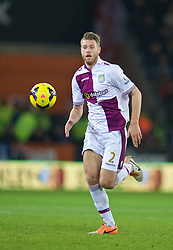 CARDIFF, WALES - Tuesday, February 11, 2014: Aston Villa's Nathan Baker in action against Cardiff City during the Premiership match at the Cardiff City Stadium. (Pic by David Rawcliffe/Propaganda)