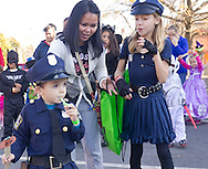 Middletown, New York  - Two children dressed as police officers enjoy the Halloween Fall Festival at the Middletown YMCA's Center for Youth Programs on Oct. 25, 2014.