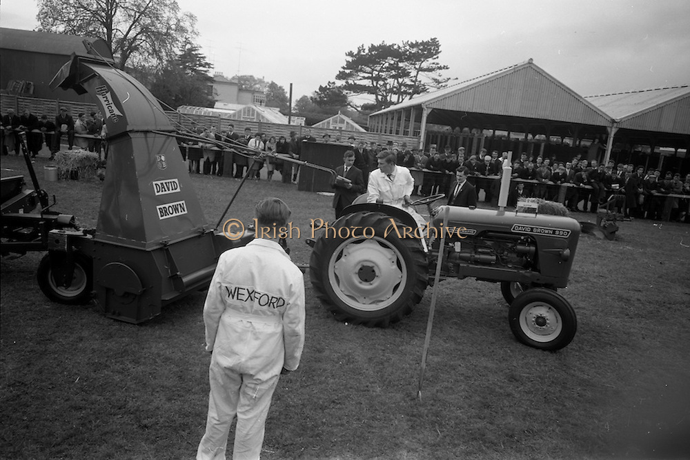 06/05/1965<br /> 05/06/1965<br /> 06 May 1965<br /> Final of the 4th Annual David Brown Tractor and Implement Maintenance Competition held at the RDS Spring Show, Ballsbridge, Dublin. John Kehoe (right), of Tincurry, Ferns, Co. Wexford winner and his helper, John Denby of Castlelands, Ferns competing in the competition.