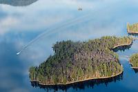 Lakes Biplane flying over Squam Lake  Merrill Island (right) November, 2012.