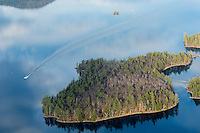 Lakes Biplane flying over Squam Lake  Merrill Island (right) November, 2012.