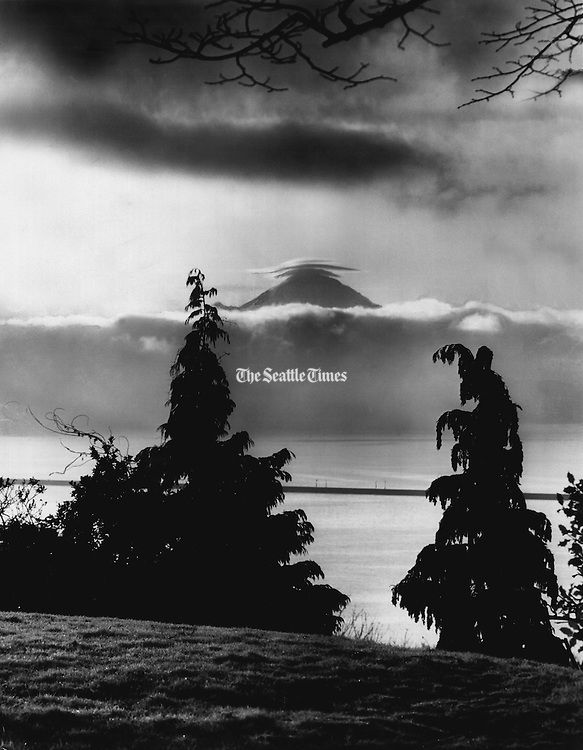Mount Rainier appeared in the clear, cold air with a halo of clouds. The view was from the Madrona Park area. The Mercer Island Floating Bridge<br />