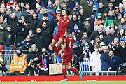 Liverpool defender Virgil van Dijk (4) celebrates his goal 1-0 during the Premier League match between Liverpool and Brighton and Hove Albion at Anfield, Liverpool, England on 30 November 2019.