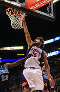 Mar. 19 2010; Phoenix, AZ, USA; Phoenix Suns center Robin Lopez (15) dunks the ball against Utah Jazz guard Wesley Matthews (23) in the first half at the US Airways Center. Mandatory Credit: Jennifer Stewart-US PRESSWIRE.