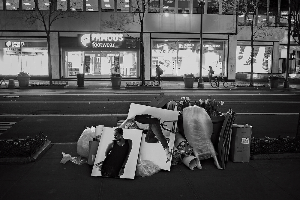 Discarded display materials outside clothing store, New York, NY, US