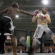 James Scibetti, right, fights Adrian Herd during Battle for a Fallen Soldier Saturday September 14, 2013 at the Wilmington Convention Center. The fights were part of a day that honored Sgt. T.J. Butler IV a local U.S. Army N.C. National Guardsman who was killed in Afghanistan. (Jason A. Frizzelle)